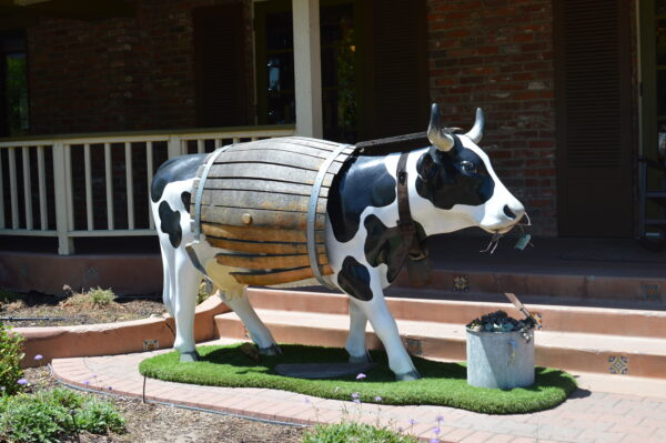 sculpture of a cow dressed in a barrel in Paso Robles