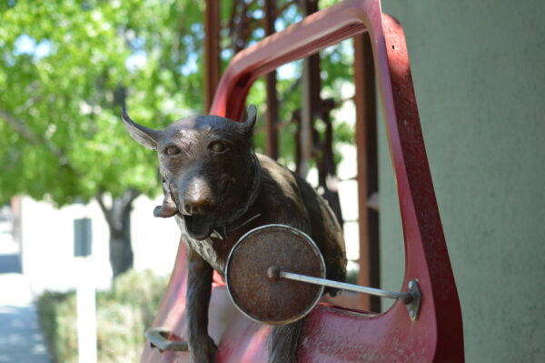 sculpture of dog in car window in paso robles